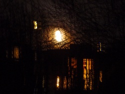 the moon over the house next door